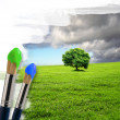 Paintbrushes and landscape - Stock Photo