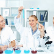 Young scientists working in laboratory — Stock Photo #10065133