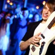 Young guitar player performing in night club — Stock Photo #10065333