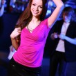 Young woman having fun at nightclub disco — ストック写真