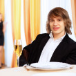 Young handsome man sitting in restaurant — Stock Photo #10065477