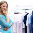 Woman in a shop buying clothes — Stock Photo #10065527