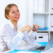 Young woman in business wear working in office — Stock Photo #10065754