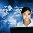 Young woman in business wear and headset — Stock Photo #10065828