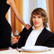Young handsome msitting in restaurant — Stock Photo #10065842