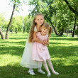 Two little sisters in the summer park - Foto de Stock