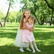 Two little sisters in the summer park — Stock Photo