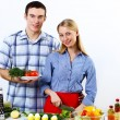 Husband and wife together coooking at home - ストック写真