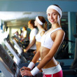 Young woman doing sport in gym — Stock Photo #10066237