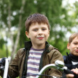 Boy on a bicycle in the green park — Stock Photo #10066310