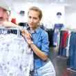 Woman in a shop buying clothes — Stock Photo #10066364
