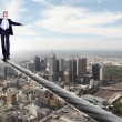 Business man balancing on the rope - Foto Stock