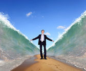 Businessman surfing on the sea waves — Stock Photo
