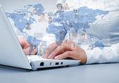 Portatile su sfondo di tecnologia — Foto Stock