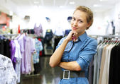 Woman in a shop buying clothes — ストック写真