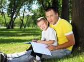 Father with his son in the par — Stock Photo