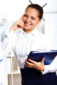 Young beautiful woman in business wear at work — Stock Photo