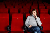Young man in cinema watching movie — Photo