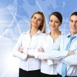 Three successful young business persons together — Stock Photo #10123643
