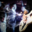 Young guitar player performing in night club — Stock Photo #10123853