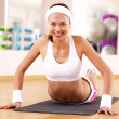 Young woman doing sport in gym — Stock Photo #10124437