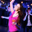 Young woman having fun at nightclub disco — Stock Photo #10127587