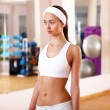 Young woman doing sport in gym — Stock Photo #10127613