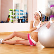 Young woman doing sport in gym — Stock Photo #10127653