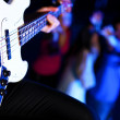 Young guitar player performing in night club — Stock Photo #10127665