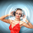 Royalty-Free Stock Photo: Young woman in evening dress with headphones