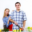 Husband and wife together coooking at home — Stock Photo