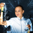 Stock Photo: Young chemist working in laboratory