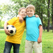 Foto Stock: Boys in park with ball