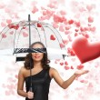 Pretty young woman with umbrella and hearts — Stock Photo #10127961
