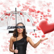 Royalty-Free Stock Photo: Pretty young woman with umbrella and hearts