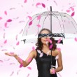 Pretty woman under umbrella with petals around her — Stock Photo #10128062