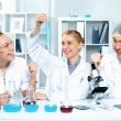 Young scientists working in laboratory - Stock Photo