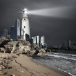 Lighthouse with a beam of light — Stock Photo #10128333