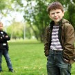 Boy with a friend in the green park — Stock Photo #10128401