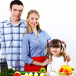 Family with a daughter cooking together at home — Stock Photo #10128520