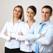 Three successful young business persons together — Stock Photo #10128660