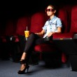 Young girl in cinema — Stock Photo #10128671