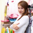 Young woman inside a store buying clothes — Stock Photo #10128874