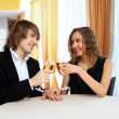Couple in a restaurant with shampagne — Stock Photo #10129055