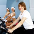Young man doing sport in gym — Stock Photo #10129130