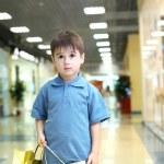 Little boy doing shopping — Stock Photo