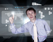 Businessman working with virtual computer screen — Stock Photo