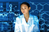 Young chemist working in laboratory — Stock Photo