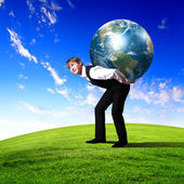 Young businessman carrying world — Stock Photo