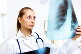 Friendly doctor in medical office — Stock Photo